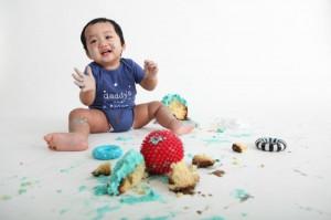 1 year old boy baby photo smashing cake